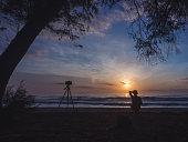 silhouette man enjoying sunrise at beach