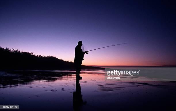 Silhouette of Man Fishing at Sunset