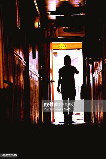 Silhouette Of Man In Corridor