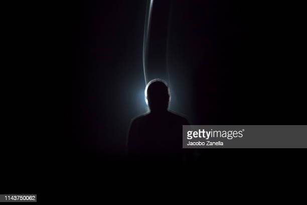 silhouette of man in dark tunnel - unrecognizable person stock pictures, royalty-free photos & images