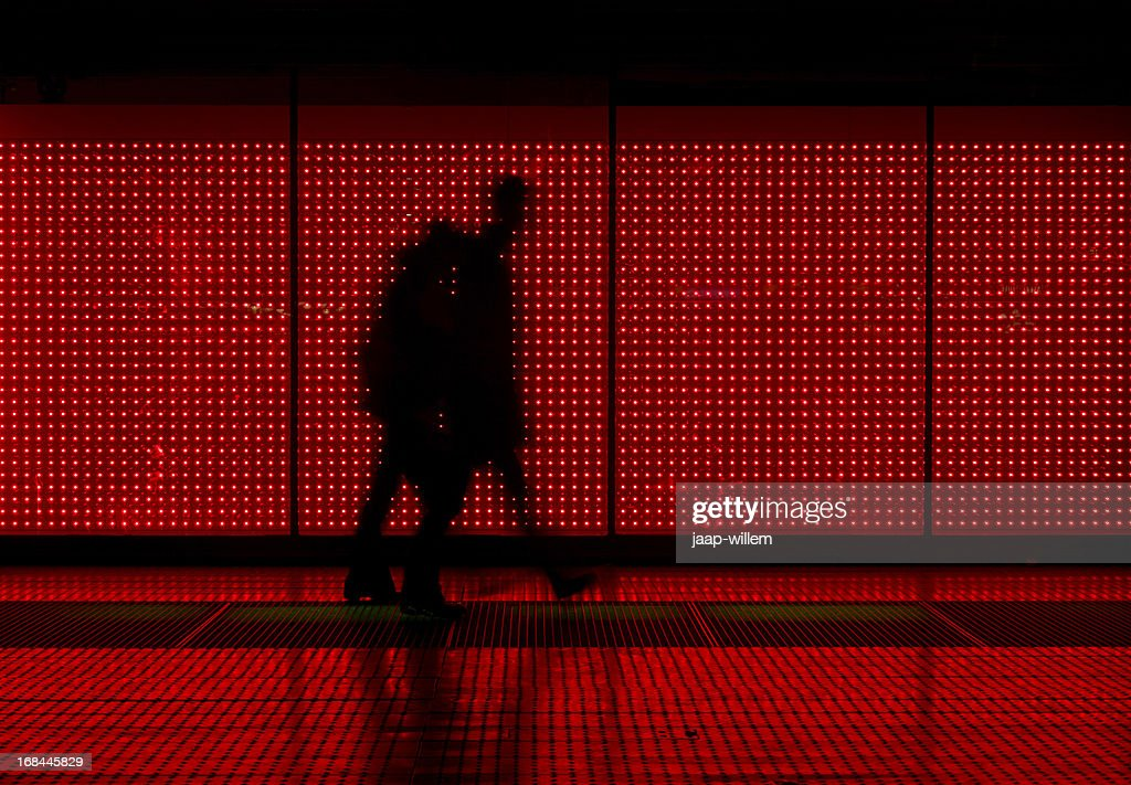 Silhouette of man moving in red background : Stock Photo