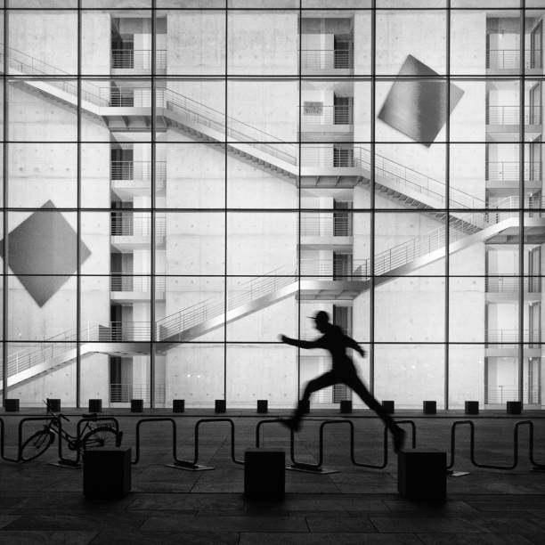 Silhouette of man running on street, Government District, Berlin, Germany