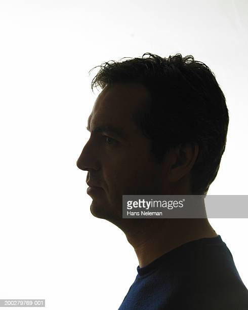 Silhouette of man, side view, close-up