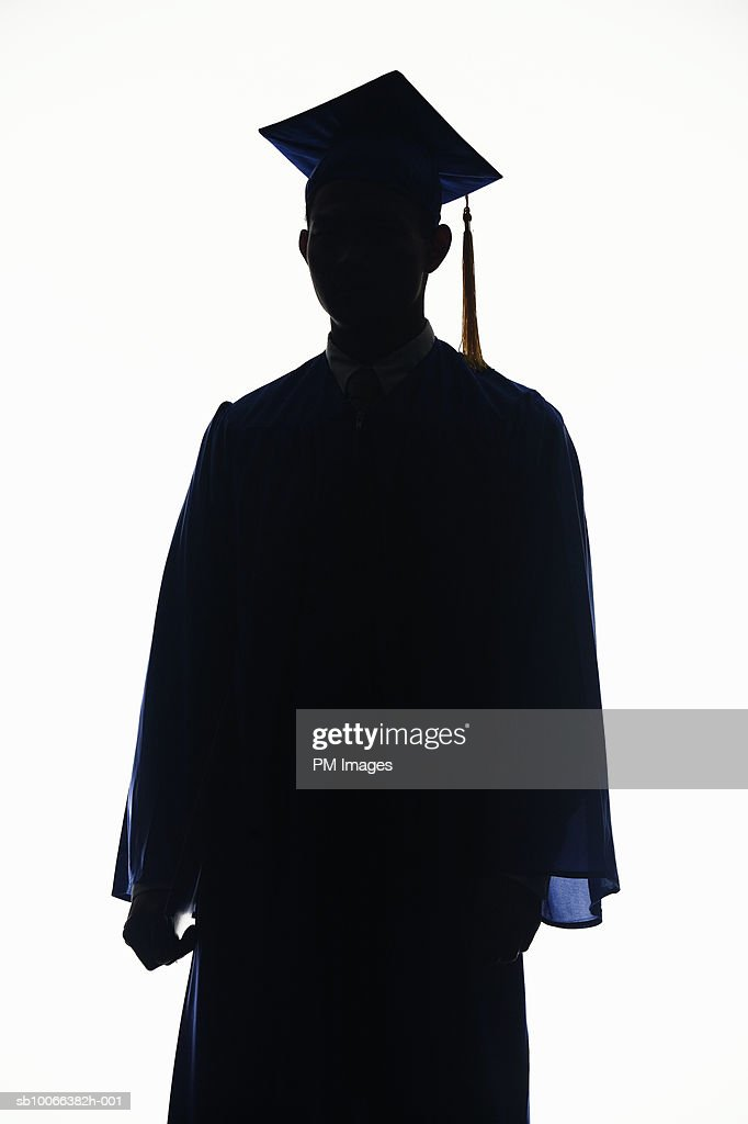 Silhouette Of Man Wearing Graduation Cap And Gown Against