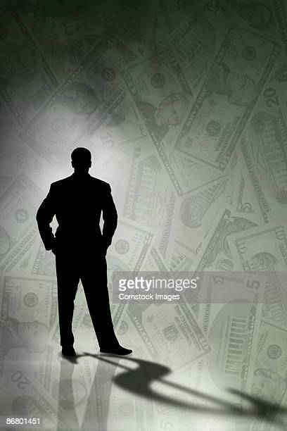 Silhouette of man with money