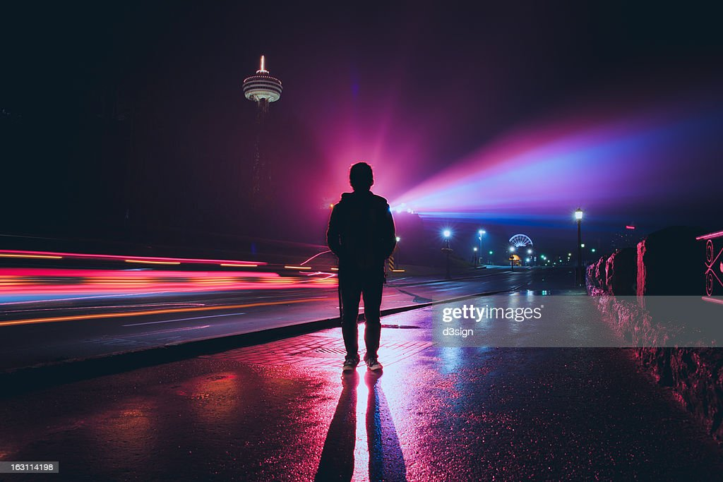 Silhouette of man with spectacular colorful light : Stock Photo