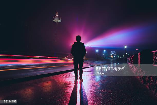 silhouette of man with spectacular colorful light - long exposure stock pictures, royalty-free photos & images