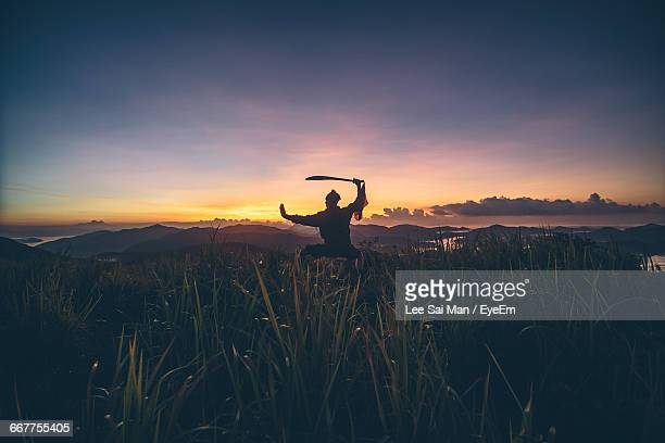 Silhouette Of Man With Sword
