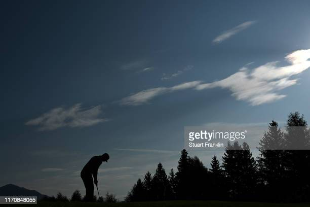 Silhouette of Matt Wallace of England as he putts on the tenth during Day One of the Omega European Masters at Crans Montana Golf Club on August 29,...