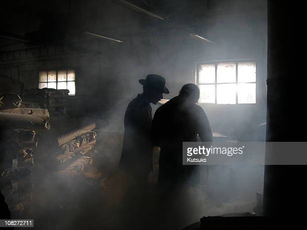 silhouette of men in smoke - conspiracy stock pictures, royalty-free photos & images