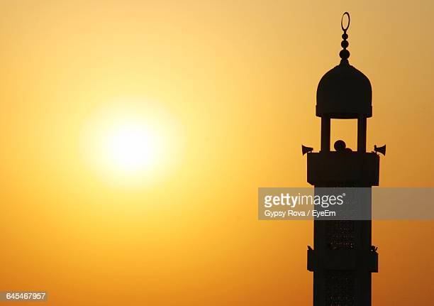 silhouette of minaret during sunset - minaret stock pictures, royalty-free photos & images