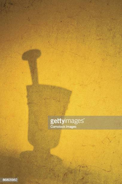 Silhouette of mortar and pestle
