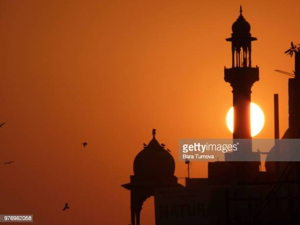 Silhouette of mosque at sunset, New Delhi, India