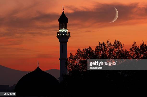 silhouette of mosque with crescent moon at dusk - mosque stock pictures, royalty-free photos & images