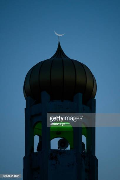 silhouette of mosque with moon - mosque stock pictures, royalty-free photos & images