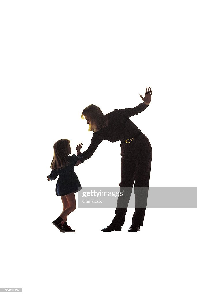Silhouette of mother about to strike daughter : Stock Photo