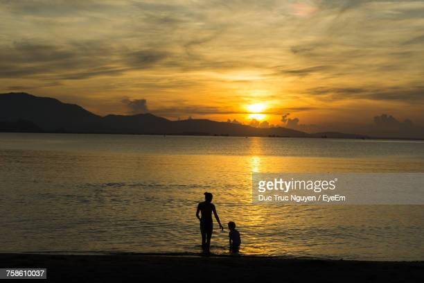 silhouette of mother and child - pretty vietnamese women stock pictures, royalty-free photos & images