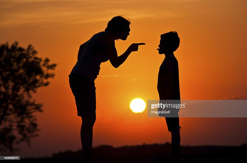 Silhouette of Mother Scolding A Disrespectful Child : Stock Photo