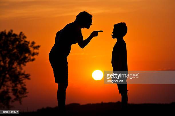silhouette of mother scolding a disrespectful child - mother scolding stock pictures, royalty-free photos & images
