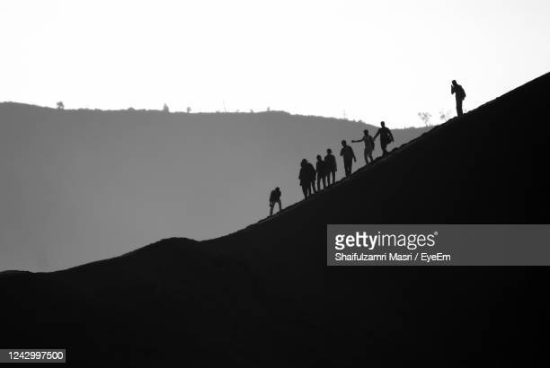 silhouette of mountain against clear sky - shaifulzamri stock pictures, royalty-free photos & images