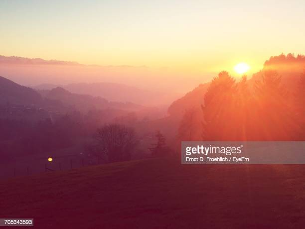 silhouette of mountain against sky at sunset - wald stock pictures, royalty-free photos & images