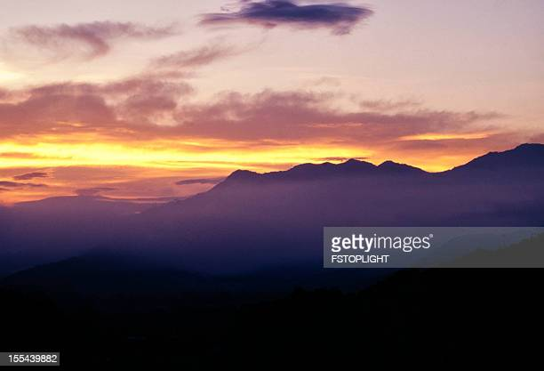 silhouette of mountain - fstoplight stock photos and pictures
