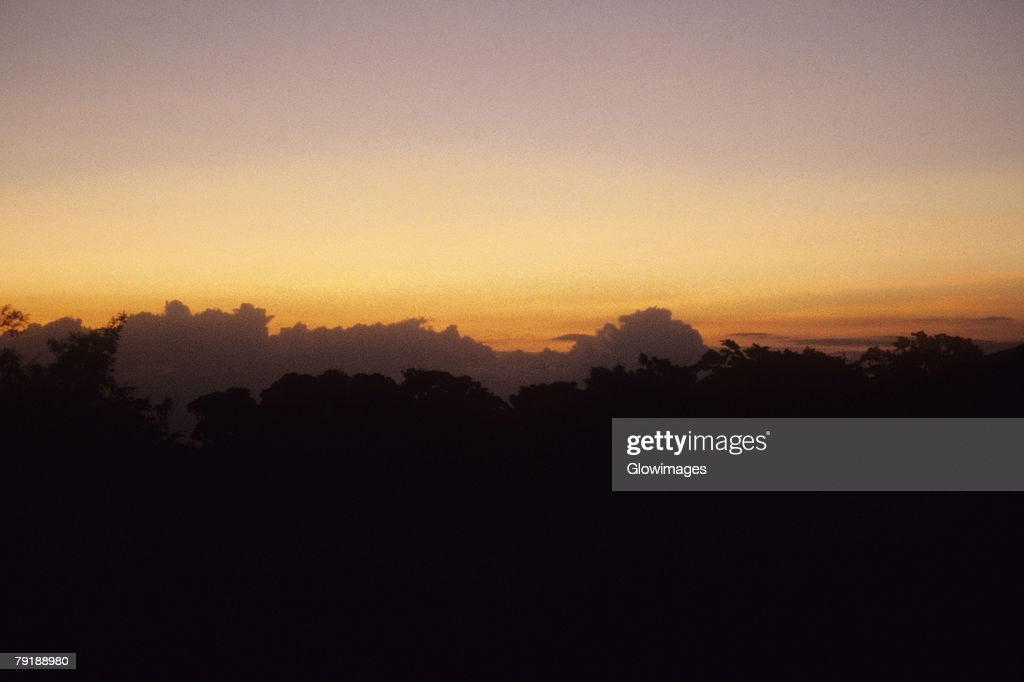 Silhouette of mountains at dusk, Costa Rica : Foto de stock
