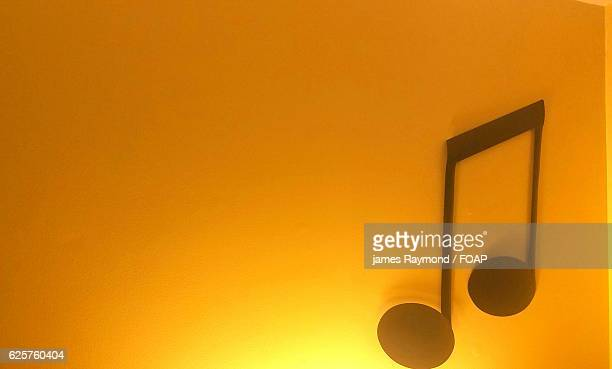 Silhouette of musical note on wall
