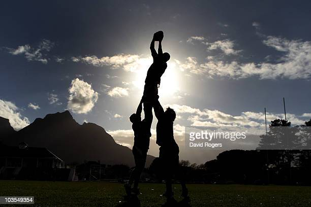 Silhouette of Nathan Sharpe catching the ball during an Australian Wallabies training session Bishops High School on August 23, 2010 in Cape Town,...