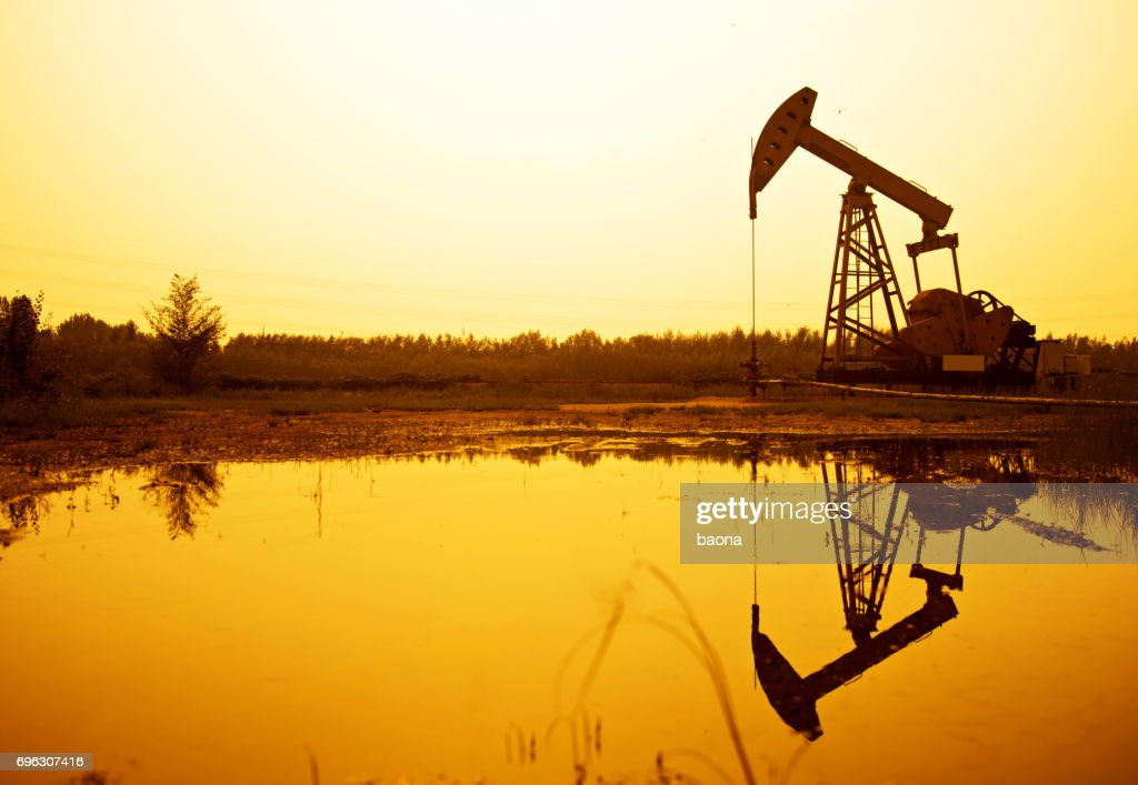 Silhouette of oil pumps at sunset : Stock Photo