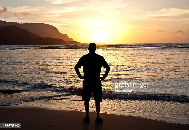 Silhouette of One Man Watching the Sunset