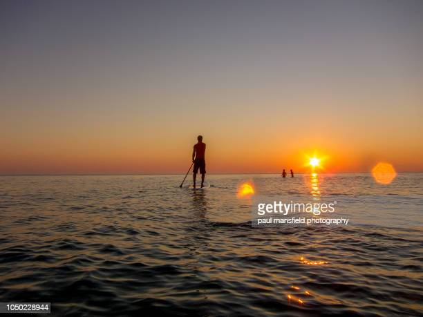 Silhouette of paddleboarder