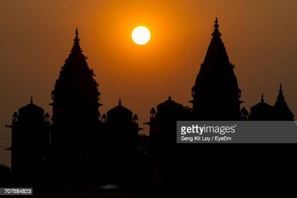 silhouette of pagoda against sunset sky - madhya pradesh stock photos and pictures