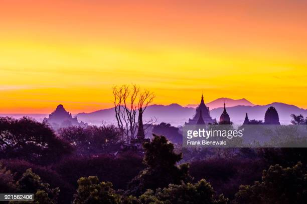 Silhouette of pagodas of Bagan in the plains of the archaeological site early morning before sunrise