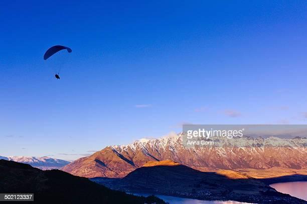 Silhouette of paraglider in winter, Queenstown, NZ