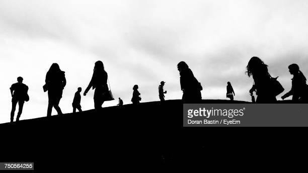 Silhouette Of People Against Sky