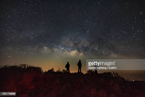Silhouette Of People At Night