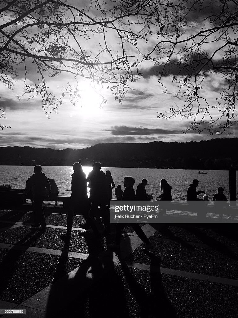 Silhouette Of People At Riverside : Foto stock