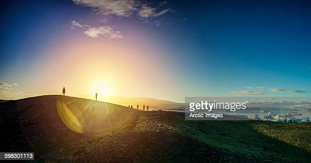 silhouette of people at the jokulsarlon, iceland - breidamerkurjokull glacier stock photos and pictures