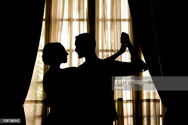 SIlhouette of People Doing Tango Dance Near Window