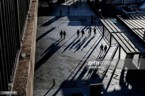silhouette of people on city street, social distancing, coronavirus pandemic, sydney, australia - generic location stock pictures, royalty-free photos & images