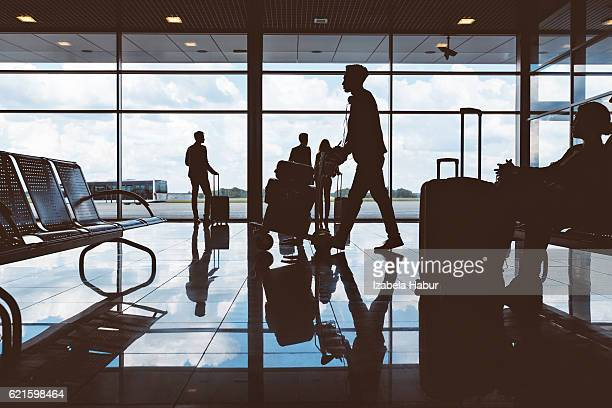 Silhouette of people waiting at airport