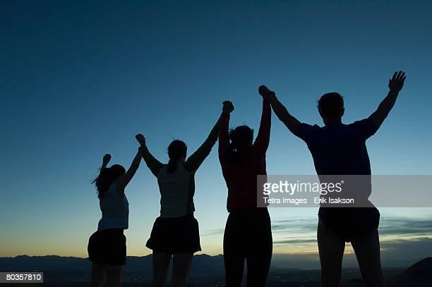 Silhouette of people with arms raised, Salt Flats, Utah, United States