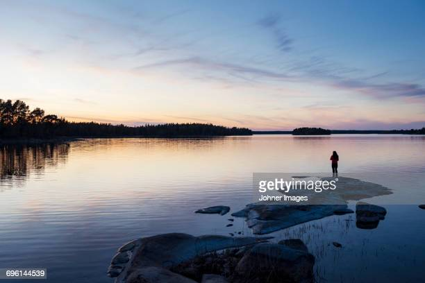 Silhouette of person at water
