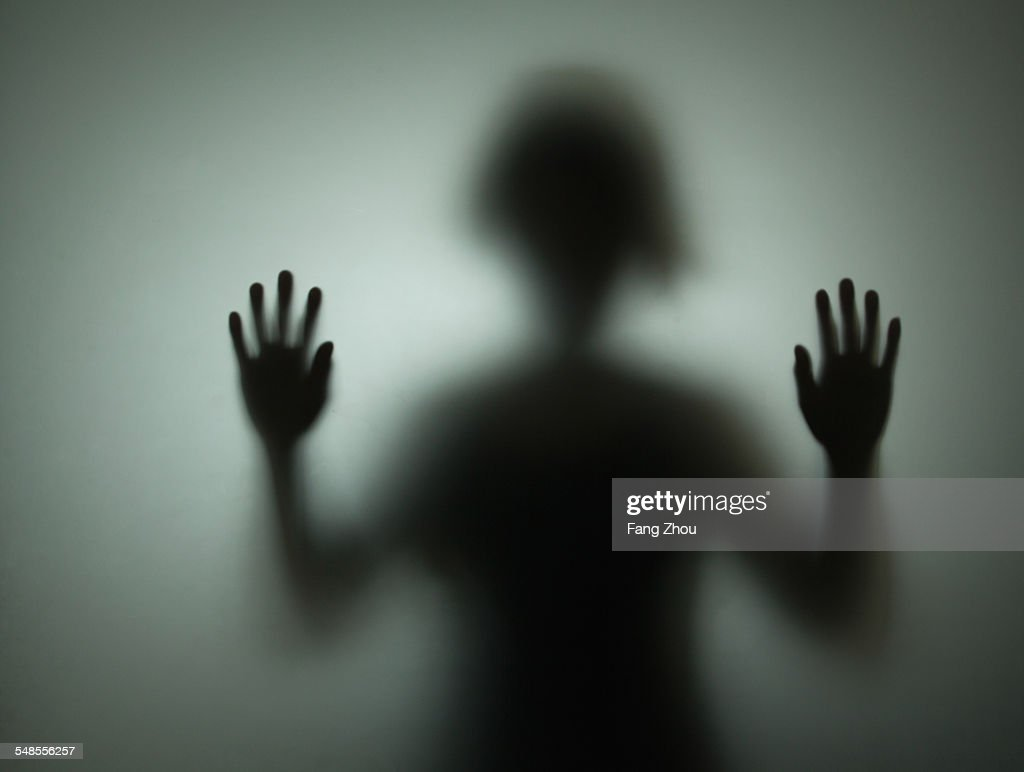 Silhouette of person behind glass : Stock Photo