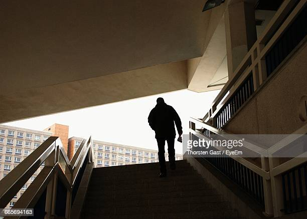 Silhouette Of Person Climbing Steps