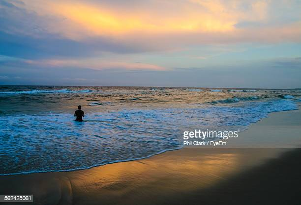 silhouette of person in water - waist deep in water stock pictures, royalty-free photos & images