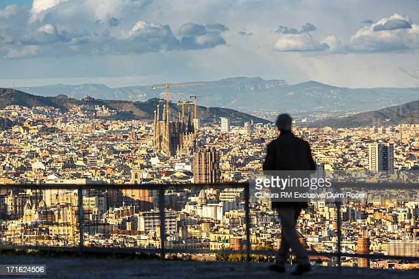 Silhouette of person looking at view of Barcelona, Catalonia, Spain