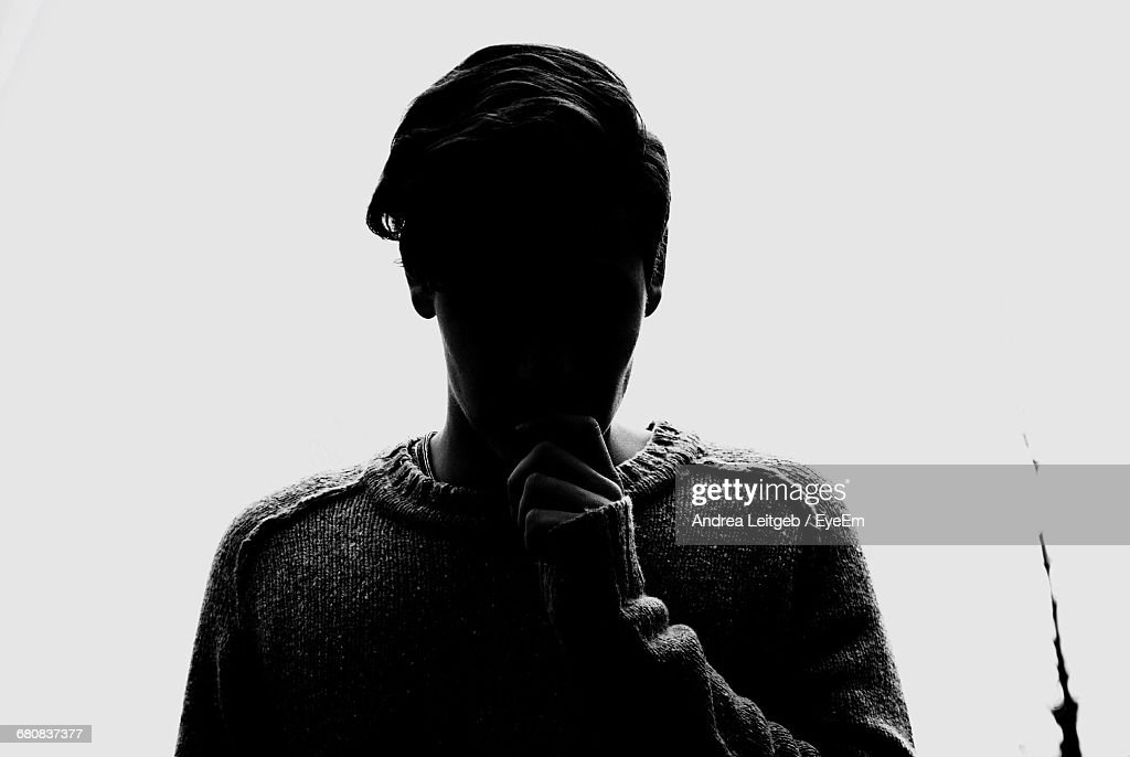 Silhouette Of Person Standing Against White Background : Stock Photo