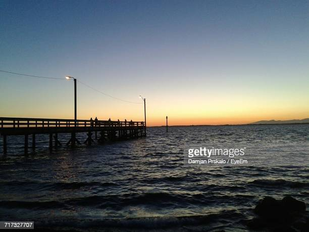 Silhouette Of Pier At Sunset